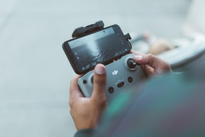 man choosing camera drone after testing functionality